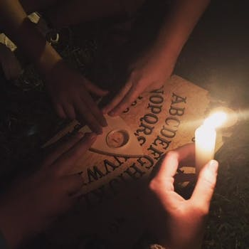 Noni, with friend RJ and fellow DTH staffers Alice and Jenni, took a Ouija board to Gimghoul Castle to see if it really is haunted.