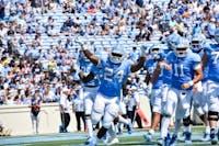 Tailback Antonio Williams (24) celebrates after scoring a touchdown. UNC won 38-35 vs. Pitt on Saturday, Sept. 22 2018.