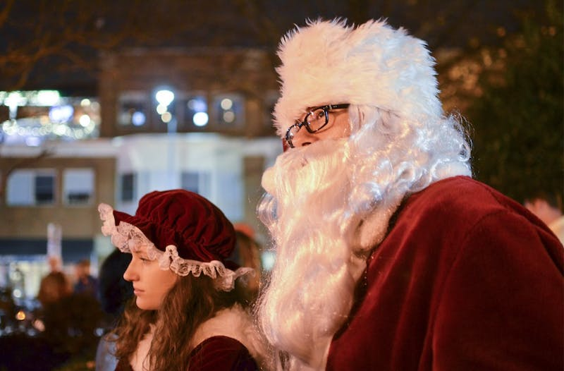 Santa Claus participates in the annual tree lighting ceremony at University Baptist Church on Sunday.