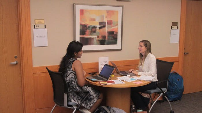Alexis Barron (right) and Sri Sure (left) manage interviews at the University Career Services Center on the 4th floor of Hanes hall on Wednesday, Sept. 26, 2018.