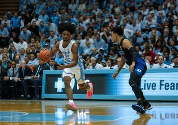First-year guard Coby White rushes down the court during the home game against Duke on Saturday, March 9 2019 at the Smith Center. The Tar Heels defeated the Blue Devils 70-79 on their senior night, finishing as ACC regular season champions.