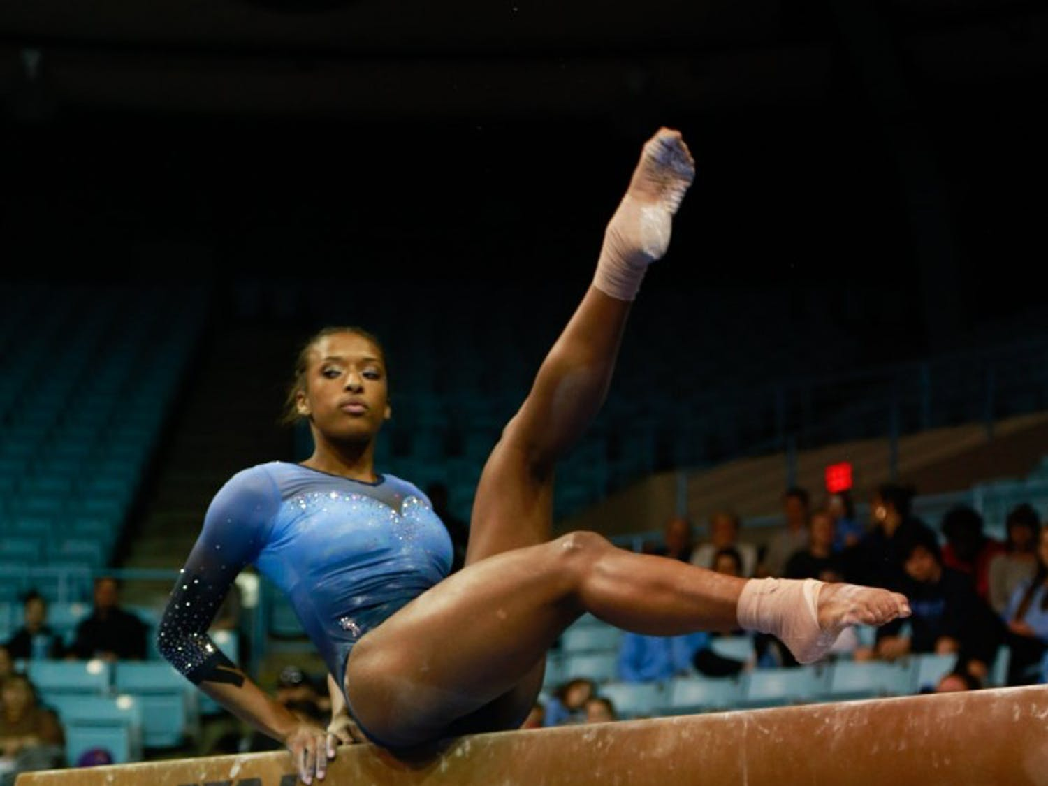 Sophomore Khazia Hislop competes in the beam event against Towson University on Saturday, Feb. 9, 2019 in Carmichael Arena.