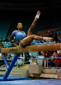 Sophomore Khazia Hislop competes in the beam event against Towson University on Saturday, Feb. 9, 2019 in Carmicheal Arena.