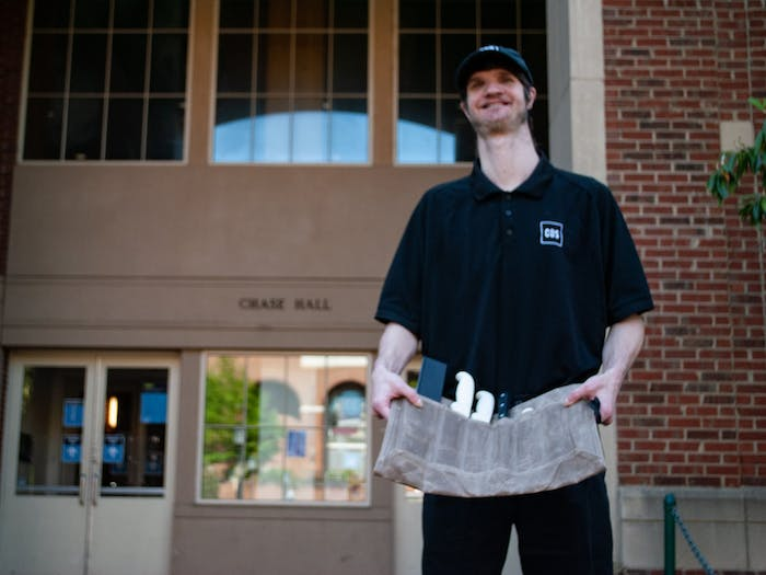 Sam Wagner poses for a portrait outside of Chase Dining Hall. he has been awarded by Chef Hunter Stegall for his hard work and dedication in food preparation.