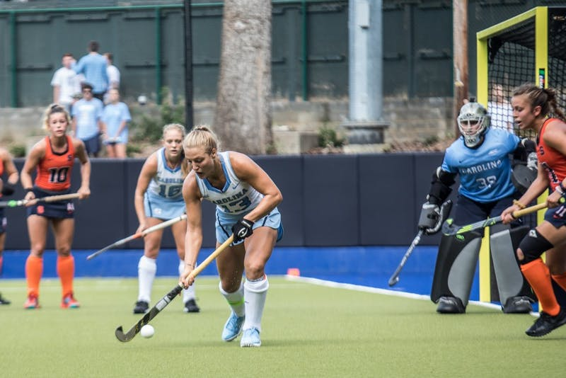 Senior Back Ashley Hoffman (13) of the UNC Field Hockey team defends the ball against Syracuse in a 5-1 win on Saturday, Sept. 29, at Karen Shelton Stadium in Chapel Hill, NC.