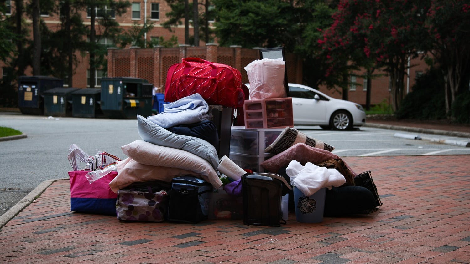 Items from a student's dorm sits in a pile outside Hinton James Residence Hall on Tuesday, Aug. 18, 2020. Students began to move out of various residence halls on campus after the announcement that all undergraduate classes would be moving online for the Fall 2020 semester.