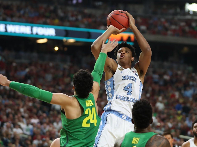 North Carolina forward Isaiah Hicks (4) fades away over forward Oregon Dillon Brooks (24) in the teams' Final Four matchup on Saturday in Phoenix.