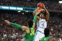 North Carolina forward Isaiah Hicks (4) fades away over forward Oregon Dillon Brooks (24) in the teams' Final Four matchup on Saturday in Phoenix.