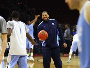 Sean May hands the ball back to Theo Pinson (1).