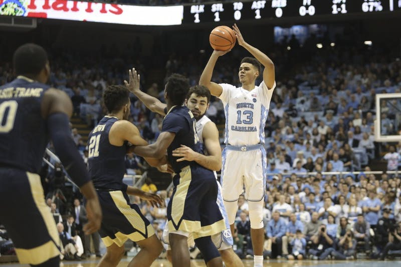Guard Cameron Johnson (13) shoots a 3-pointer against Pittsburgh on Feb. 3 in the Smith Center.