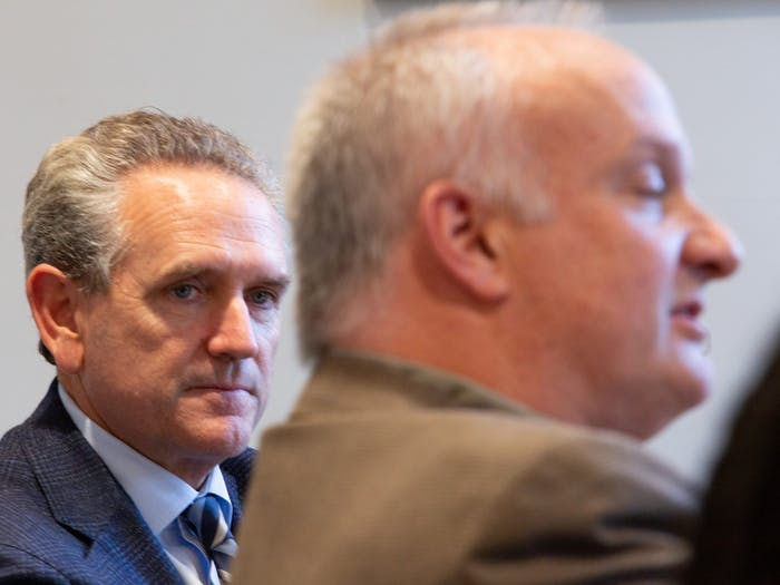"""Bubba Cunningham, UNC's athletic director, listens as Allan Blattner, director of Carolina Housing, speaks during a Faculty Athletics Committee meeting in South Building on Thursday, Jan. 9, 2020. """"I think in my mind our relationship with athletics is very strong,"""" Blattner said."""