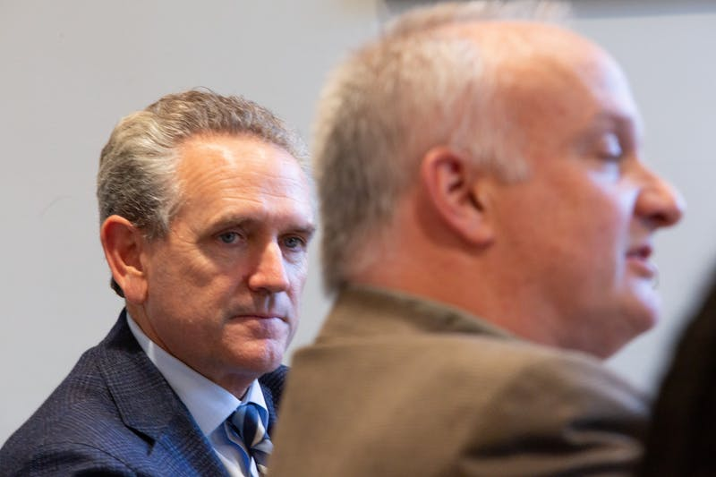 "Bubba Cunningham, UNC's athletic director, listens as Allan Blattner, director of Carolina Housing, speaks during a Faculty Athletics Committee meeting in South Building on Thursday, Jan. 9, 2020. ""I think in my mind our relationship with athletics is very strong,"" Blattner said."