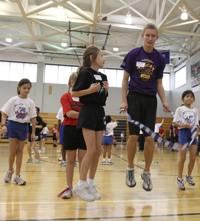 Brandon Kelly of the Bouncing Bulldogs jump ropes with kids during the 21st Annual N.C Rope Skipping Workshop on Saturday.