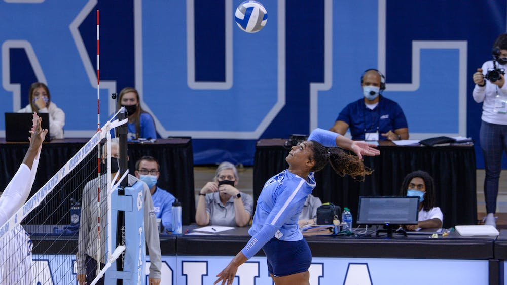 <p>UNC graduate student outside hitter Nia Robinson (18) hits the ball at the game against Pittsburgh on Sept. 24 at Carmichael Arena. UNC lost 1-3.</p>