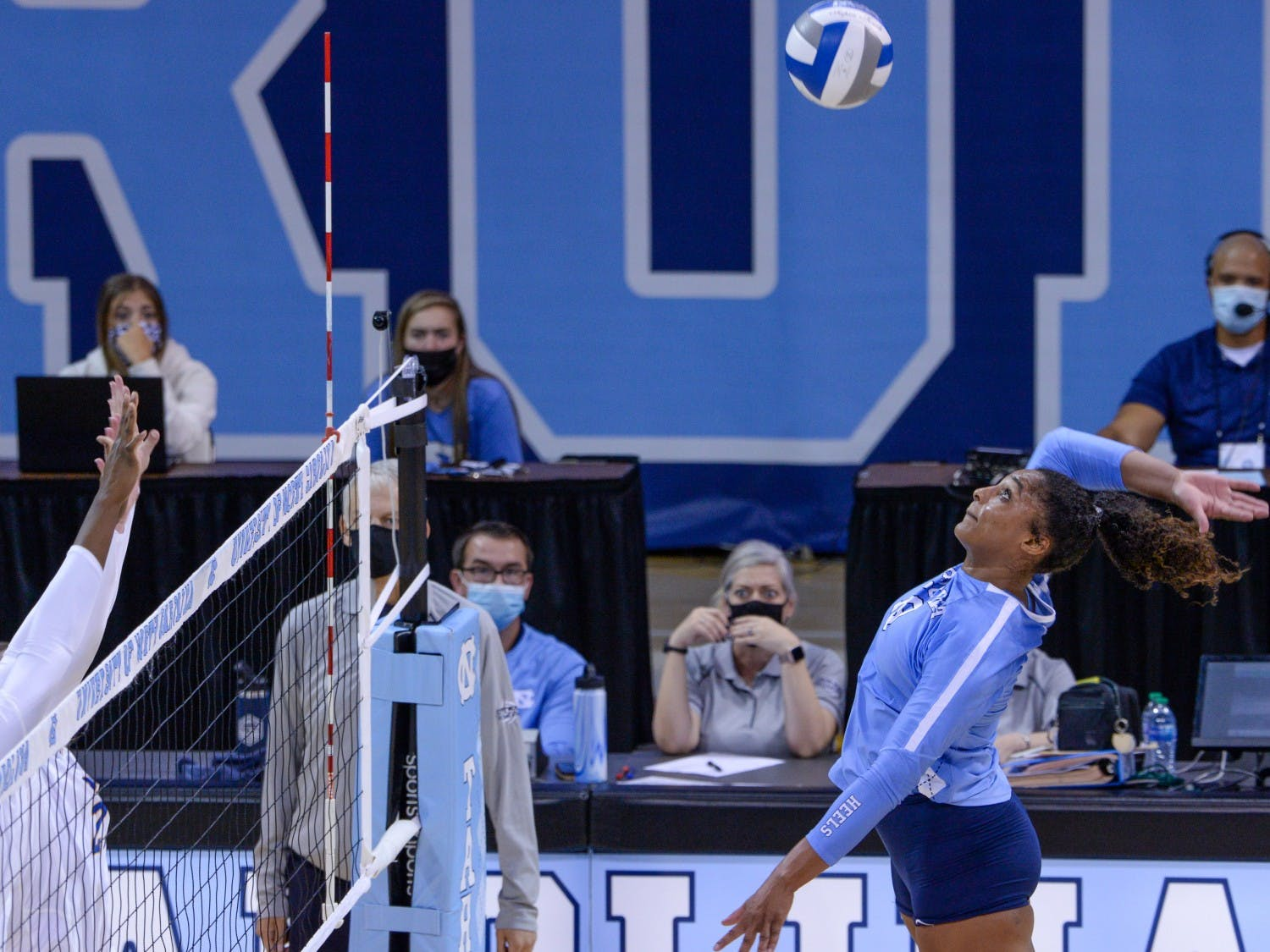 UNC graduate student outside hitter Nia Robinson (18) hits the ball at the game against Pittsburgh on Sept. 24 at Carmichael Arena. UNC lost 1-3.