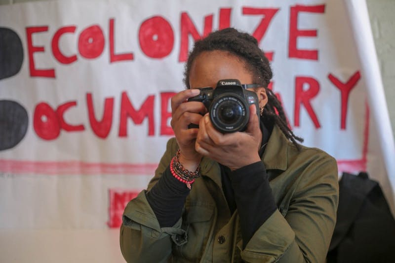 Courtney Staton, a senior photojournalism and psychology student and NeXt Doc Fellow, in Carroll Hall Saturday, March 24, 2019. Staton was one of the individuals who spoke out against the misrepresentation of students of color in the documentary known as The Commons. The Commons is a documentary film which focused on protests surrounding the Silent Sam confederate statue, but following the films unveiling many felt that the representation of the protests were disproportionate and did not accurately portray the individuals involved. Several of the individuals who were featured prominently in the film were not aware that they were being featured and did not consent to taking being shown in the film.