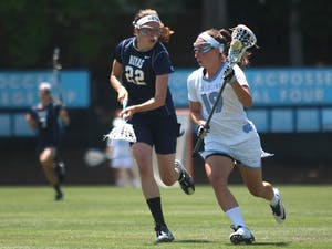 Sarah Scott advances the ball toward the goalduring Sunday afternoon's NCAA tournament game against Georgetown.