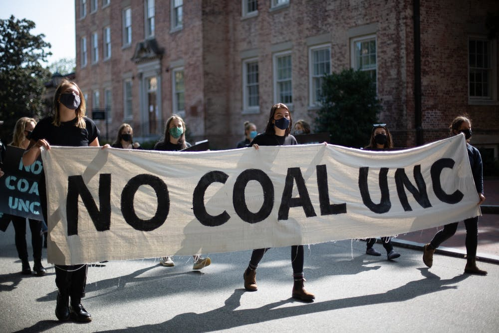 Students march down Cameron Ave. on Tuesday, Sept. 22, 2020 to protest UNC's coal plant.