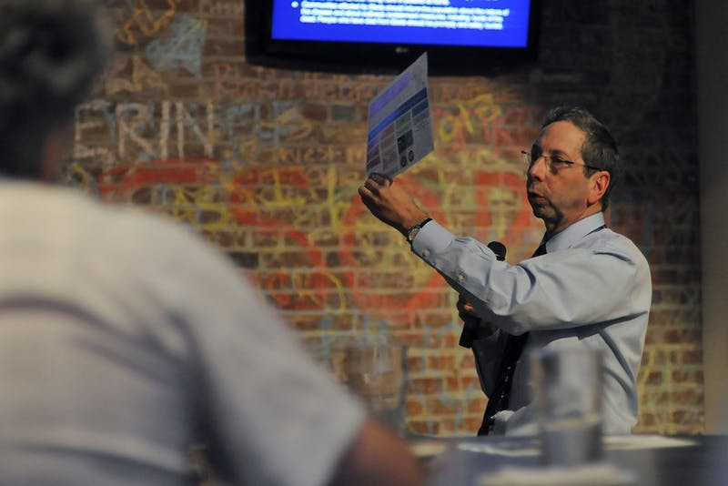 Dr. David Weber speaks at Morehead Planetariums's science awareness program, Carolina Science Cafe, in Top of the Hill's Back Bar.  At monthly educational program for adults, he spoke about the recent outbreak of Ebola in West Africa.