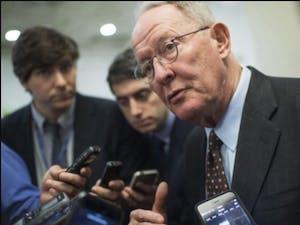 Sen. Lamar Alexander (R-Tenn.) talks with reporters on Nov. 29, 2016, before the Senate Policy Luncheons in the U.S. Capitol. (Tom Williams/Congressional Quarterly/Newscom/Zuma Press/TNS)