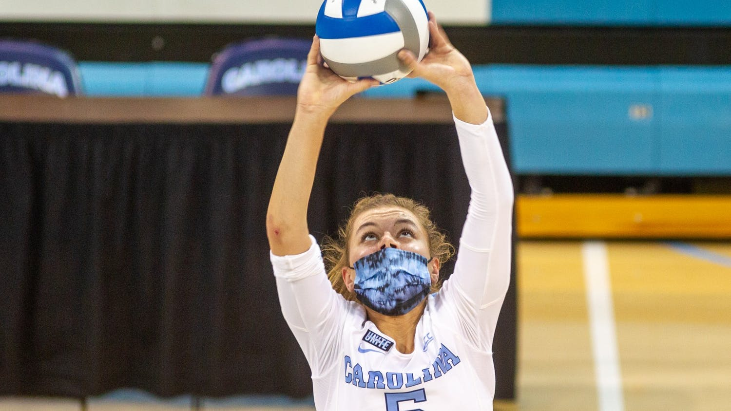 UNC Junior Annabelle Archer (5) sets the ball at the volleyball game against Virginia on Saturday, Oct. 31, 2020 at Carmichael Arena. The Tar Heels won 3-1.