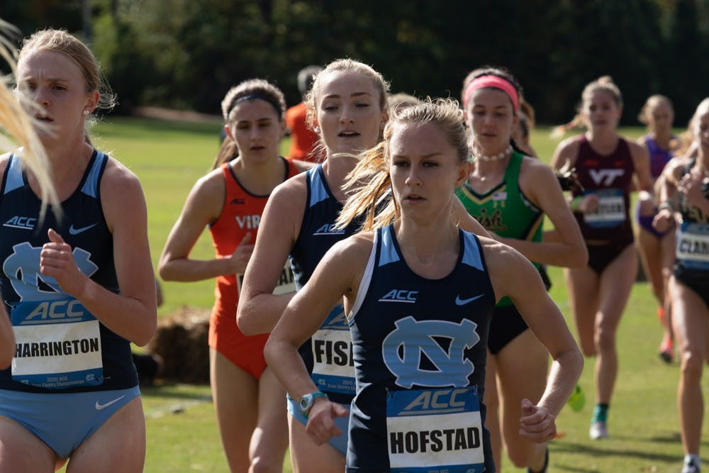 From left: Kelsey Harrington, Emmeline Fisher, and Paige Hofstad compete in the ACC Cross Country Championship on Friday, Oct. 30, 2020. The women's cross country placed 5th in the competition.