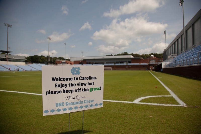 The UNC Soccer Stadium's field paint dries in the heat of a mid-August day as the entire stadium has the finishing touches put on.