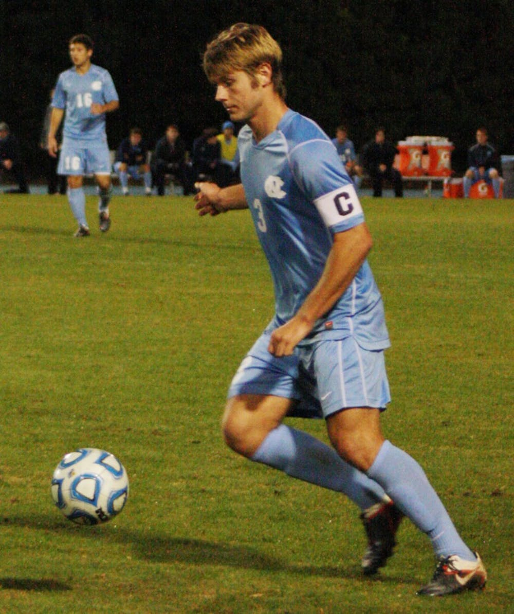 """<p>Captain Kirk Urso makes a play on the ball in Tuesday night's <span class=""""caps"""">ACC</span> Tournament quarterfinal win against N.C. State. Urso's two assists helped push <span class=""""caps"""">UNC</span> into a  semifinal game with UVa. </p>"""