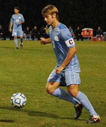 Captain Kirk Urso makes a play on the ball in Tuesday night's ACC Tournament quarterfinal win against N.C. State. Urso's two assists helped push UNC into a  semifinal game with UVa.