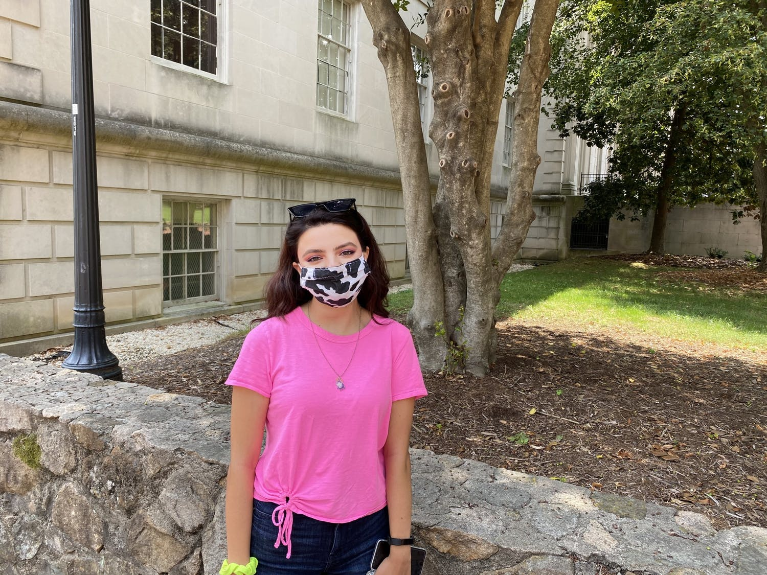 Gabriela Duncan, a junior environmental justice major, stands in front of Wilson Library on the first day of class for the fall 2020 semester. Photo by Claire Tynan.