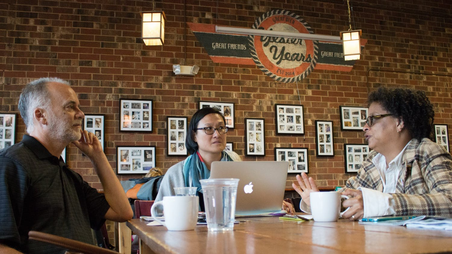 "(From left) Frank Baumgartner, Jennifer Ho and Sharon Holland discuss their collaborative ""Intersectionality: Race, Gender, Sexuality and Social Justice"" course at the Gray Squirrel coffee shop in Carrboro in 2016. Photo courtesy of Kristen Chavez, UNC College of Arts & Sciences."