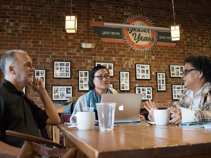 """(From left) Frank Baumgartner, Jennifer Ho and Sharon Holland discuss their collaborative """"Intersectionality: Race, Gender, Sexuality and Social Justice"""" course at the Gray Squirrel coffee shop in Carrboro in 2016. Photo courtesy of Kristen Chavez, UNC College of Arts & Sciences."""