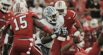 North Carolina's Romar Morris tries to escape Louisville's defense in Saturday's loss. Morris, one of two running backs filling the void left by Giovani Bernard, had five catches for 149 yards.