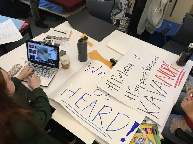 The Carolina Feminist Coalition makes posters in the Campus Y against the confirmation of Brett Kavanaugh to the Supreme Court on Thursday, Oct. 11, 2018.