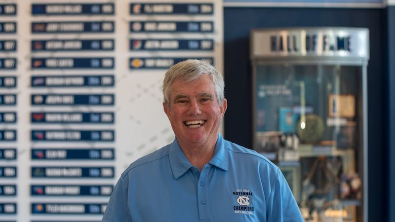 Bob Ward stands inside the Carolina Basketball Museum where he has worked as an attendant and greeter since 2008. Ward is a lifelong resident of Chapel Hill and has been a regular usher at UNC basketball games for 35 years.
