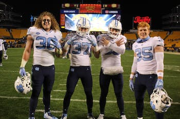 Hunter Crafford (30), Zach Goins (37), Tolson Jeffrey (95), and Chris Ripberger (35) are walk-ons to the UNC football team. Photo courtesy of Zach Goins.