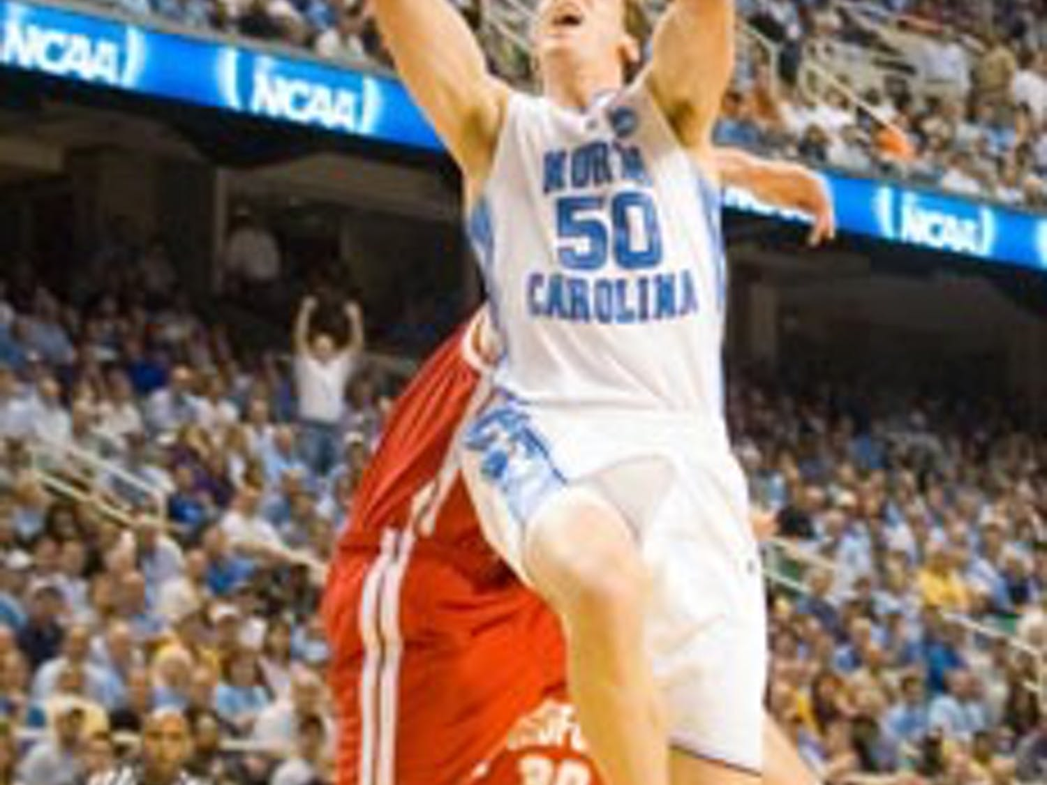 Less than five minutes into North Carolina?s first-round NCAA game against Radford on Thursday senior Tyler Hansbrough scored his third point of the game to clench a new all-time ACC career scoring record.