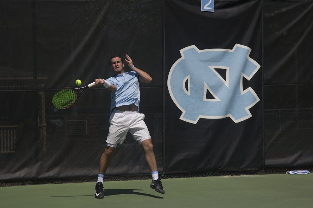 UNC Men's Tennis players William Blumberg (freshman, left) and Robert Kelly (junior, right) celebrate a point during their doubles match on Sunday afternoon against Florida State players Jose Garcia (junior) and Lucas Poullain (junior).