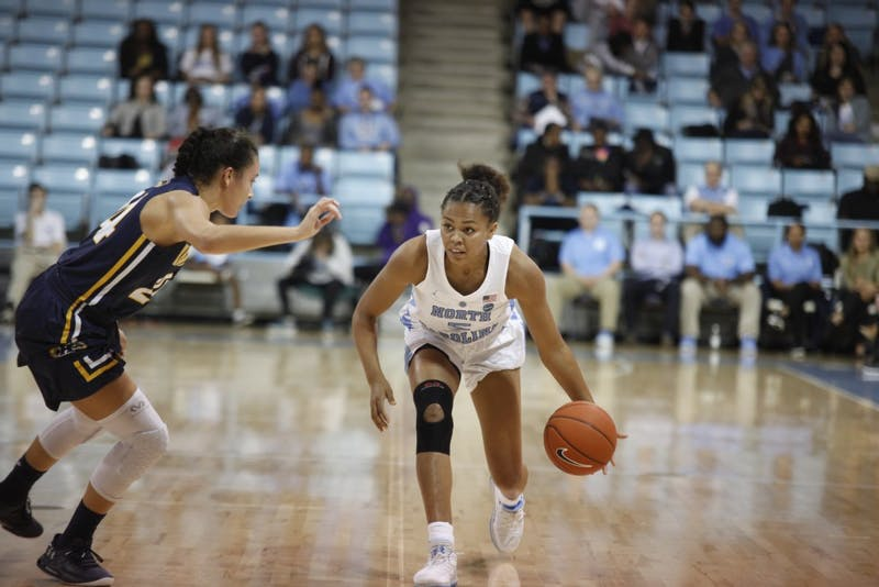 Junior guard Stephanie Watts (5) dribbles down the court during game against Kent State on Friday, Nov. 9, 2018 at Carmichael Arena. UNC won 73-60.