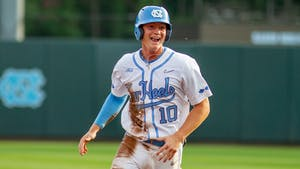 UNC first year infielder Mac Horvath (10) smiles as he runs to home base to score at the game against UNCW on Tuesday May 18, 2021 at Boshamer stadium. The Tar Heels won 14-9.