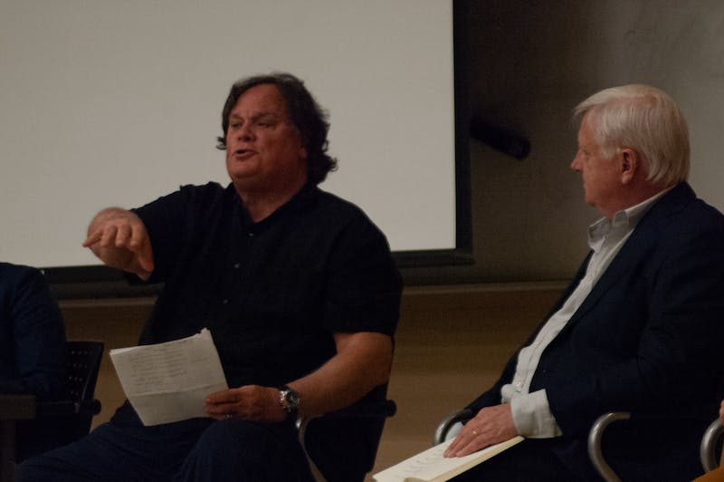 """Gene Nichol and Tim Smith, executive producer of Rigged, is photographed is speaking at a panel discussion about voting rights in North Carolina on Feb.27,2020. Here Nichol is discussing the effect of North Carolina  laws on the African American population. """"Our legislature draws lines on the basis of race, which are impermissible, unconstitstutional"""" and"""" These are the most ambitious steps at disenfranchising on the basis on race since Jim Crow Era,"""" said Nichol."""