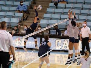 UNC sophomore outside hitter Carly Peck (13) strikes the ball during a set against Virginia during a game against the University of Virginia in Carmichael Arena on Sunday, Nov. 1, 2020. UNC finished their season that night with A 3-1 win.