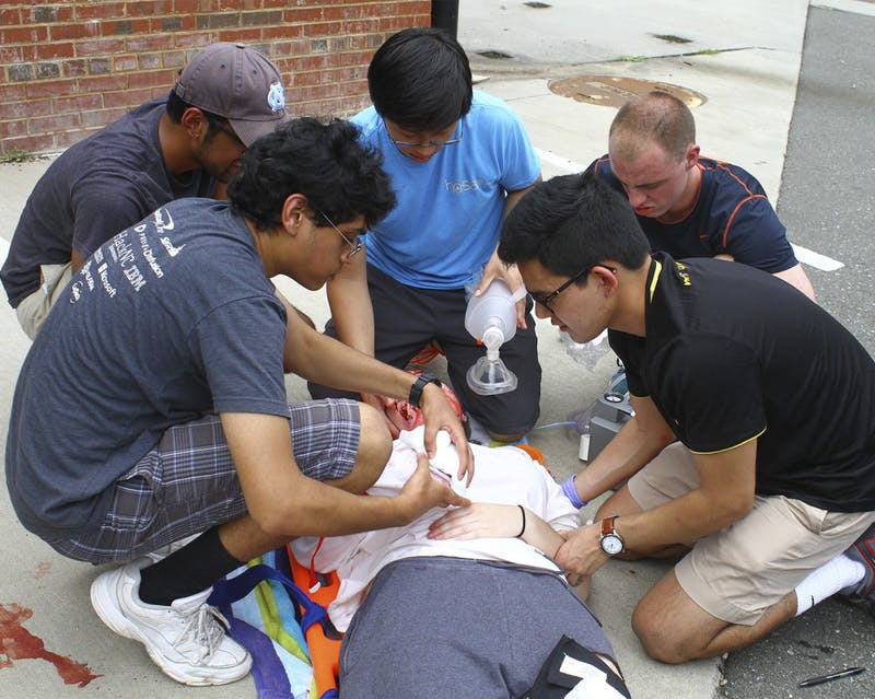 Students learn how to save a car crash victim as a part of ACERIP's Trauma Day in the organization's EMS certification class on Saturday.