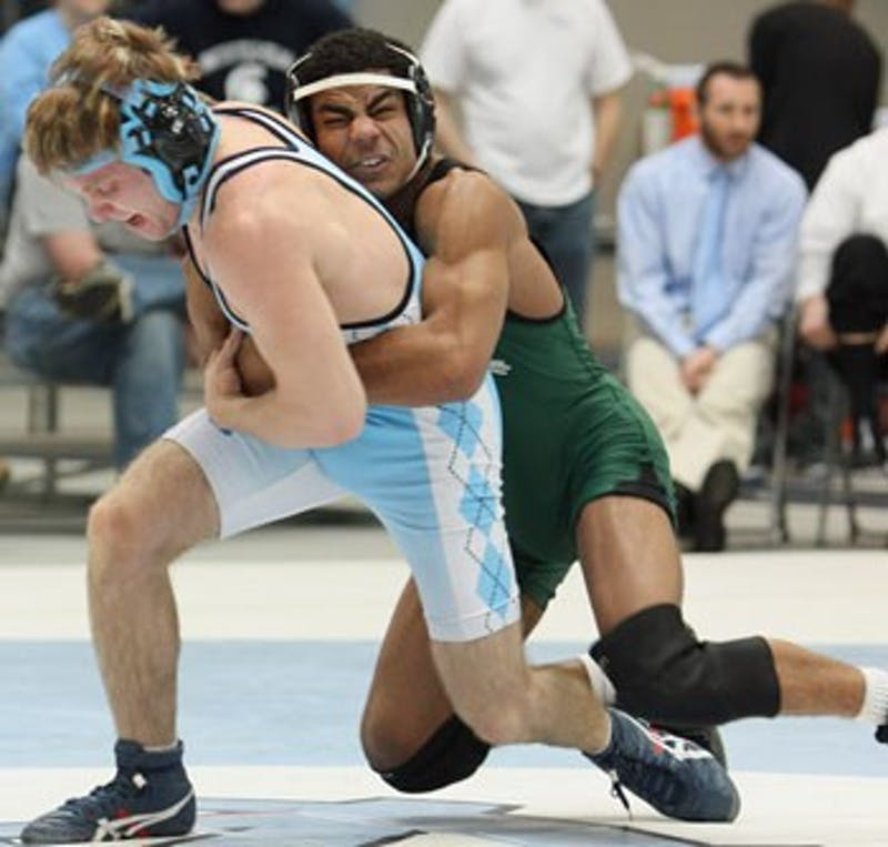 """Wrestler Justin Dobies"""" along with Keegan Mueller registered his 100th career win this season and claimed victory Saturday against Ohio State."""