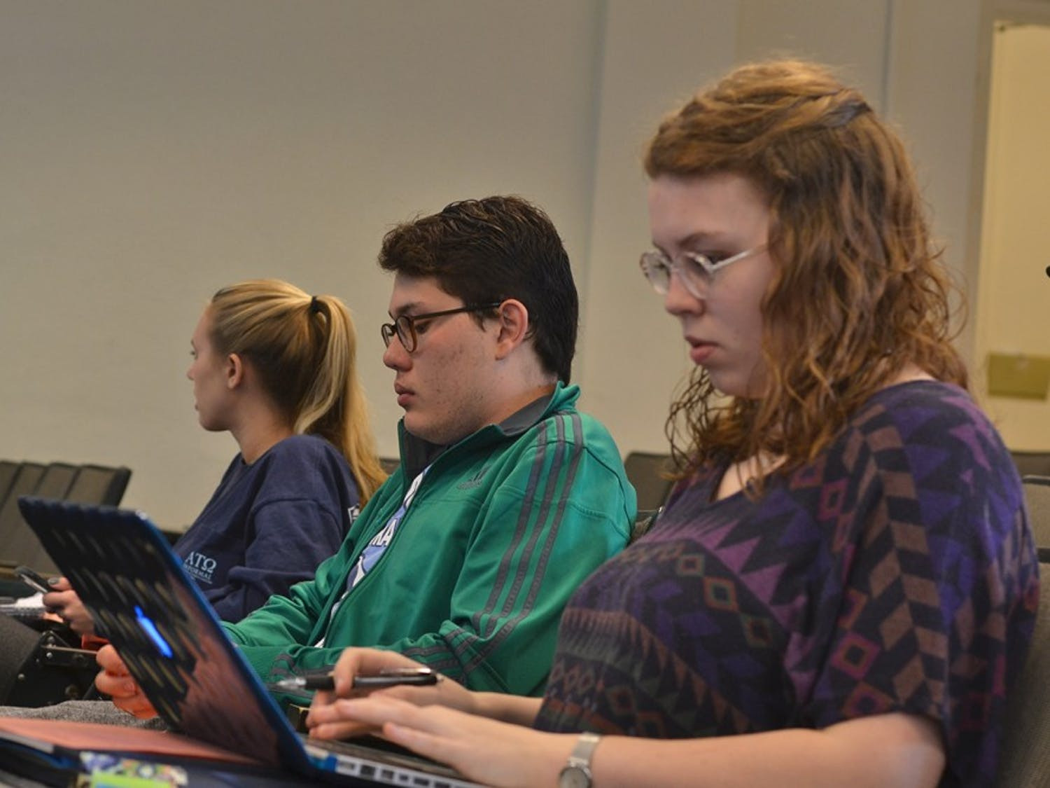 Saturday afternoon, Feb. 20, students gathered in Bingham for election protection training and to learn about primary polls. First-year Rebecca Price, sophomore Sebastian Hibbard, and junior Amanda Nunn sit among the other voters.