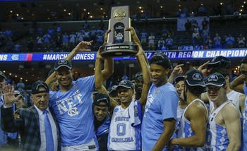 The North Carolina men's basketball team hoists up the South Regional Champion trophy fter defeating Kentucky in the Elite Eight in Memphis on Sunday.