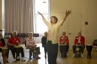 Sara Smith conducts the drum circle at the Valentines Day Party for Older Adults in Carrboro Friday afternoon.