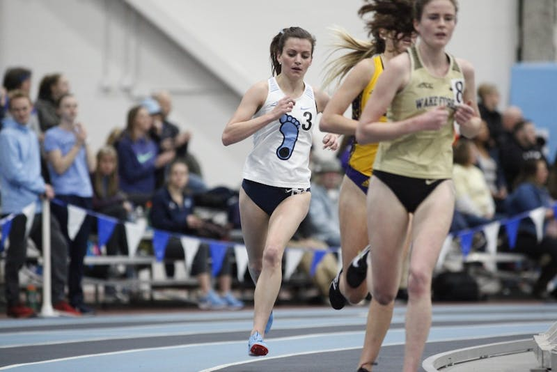 Ashley Smith, redshirt sophomore distance runner for UNC, pushes on a turn to overtake runners from Wake Forest and Eastern Carolina during the Women's 1 Mile Run in the Dick Taylor Carolina Cup at Eddie Smith Field House on Saturday, Jan. 12, 2019.