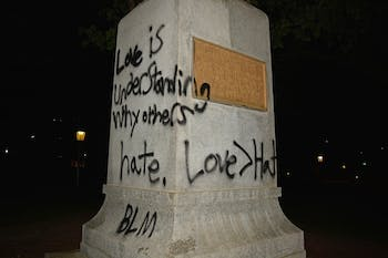 "The Silent Sam Statue was spray-painted with the words, ""Love is understanding why others hate. Love > Hate. BLM,"" on Friday night."