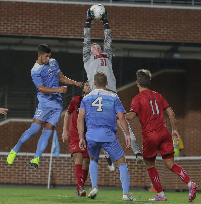 Senior Mauricio Pineda (2) goes in for a header during the game on Friday, Oct. 25, 2019 in Anson Dorrance field. UNC lost to Louisville 0-1.